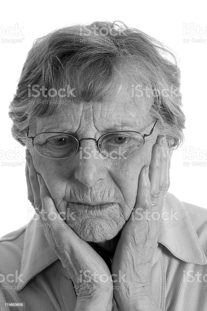 Senior woman with depression holding face royalty-free stock photo