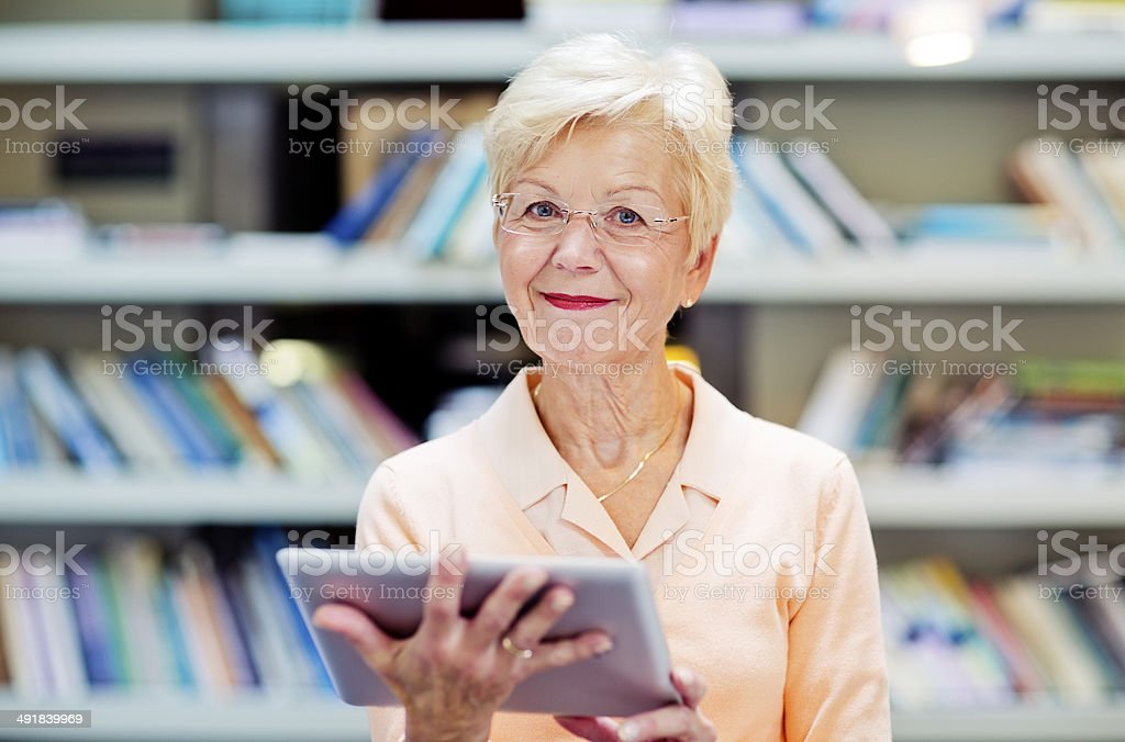 senior woman with digital tablet stock photo