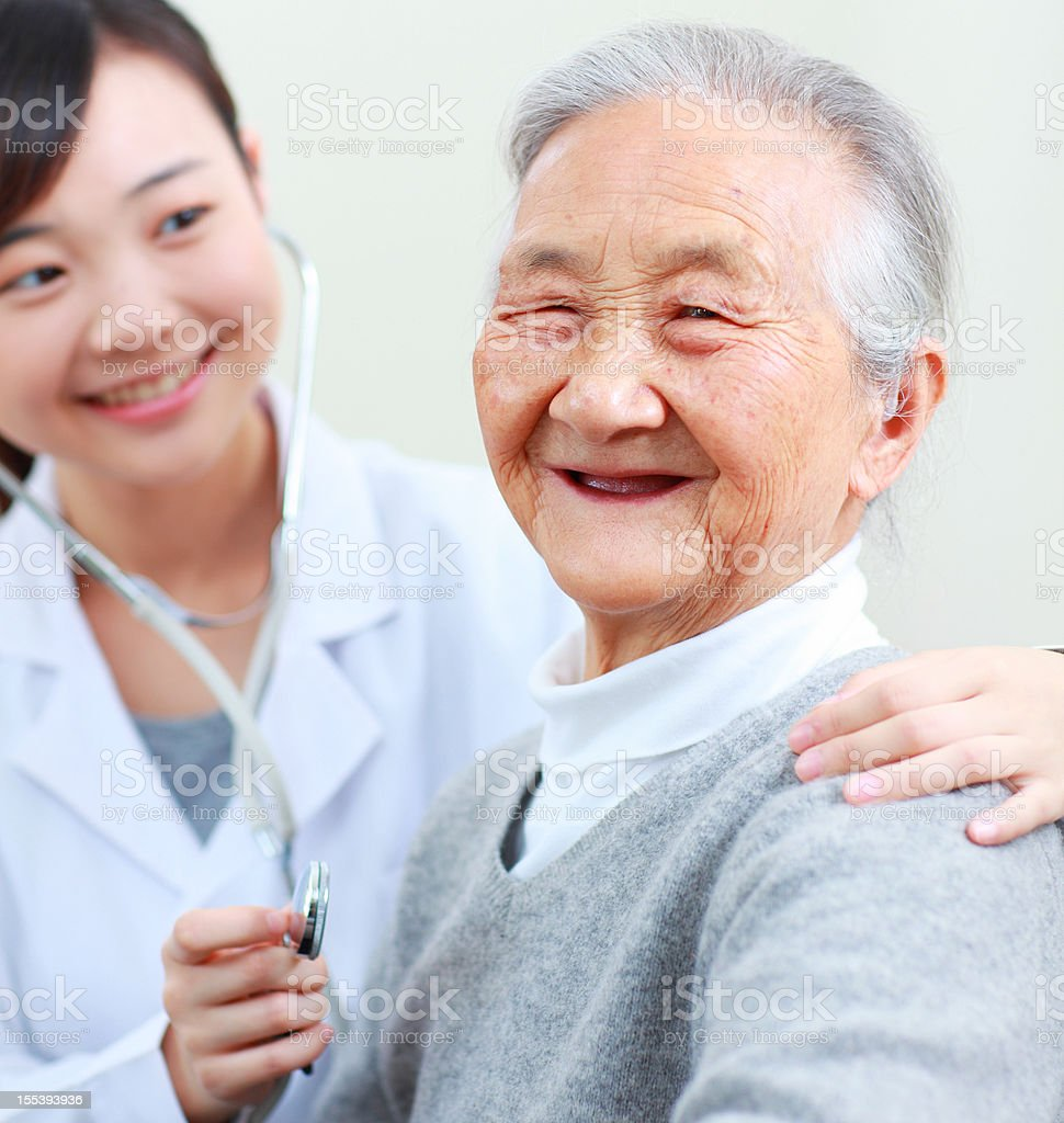 senior woman with doctor royalty-free stock photo
