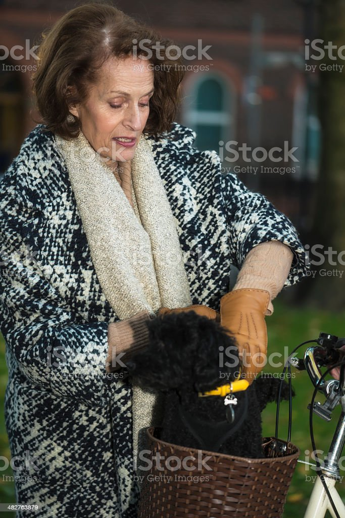 Senior woman with dog royalty-free stock photo