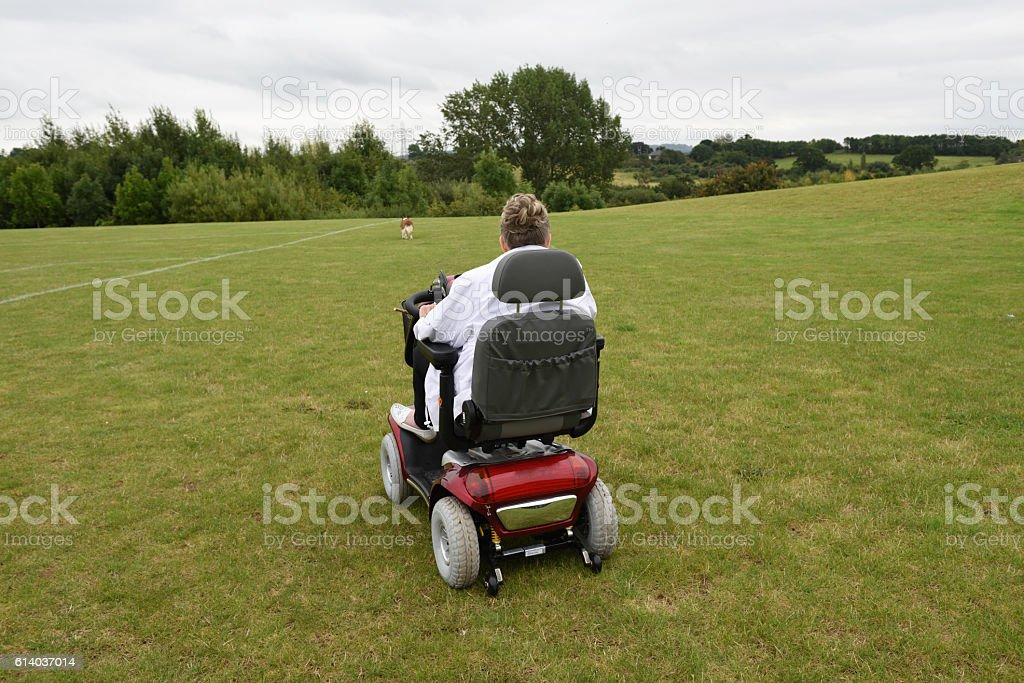 Senior woman with electric scooter stock photo