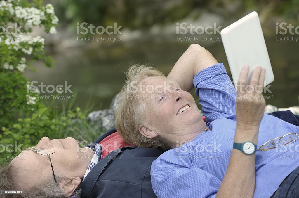 Senior woman with electronic tablet stock photo