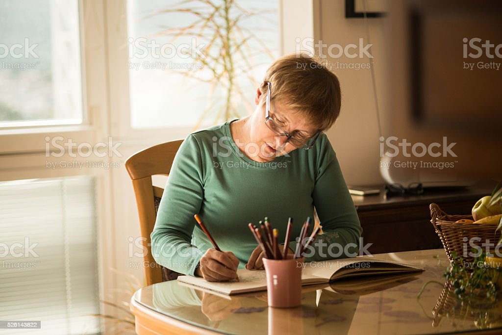 Senior Woman with Eyeglasses - Adult Coloring Books, Europe stock photo