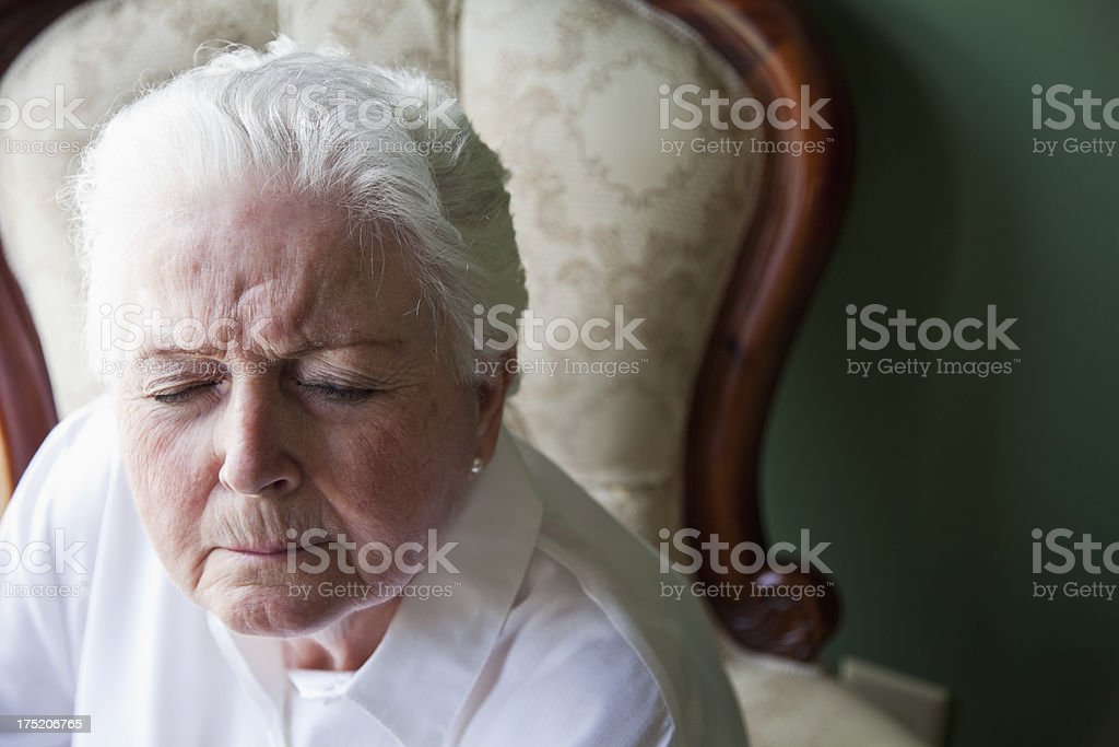 Senior woman with eyes closed stock photo