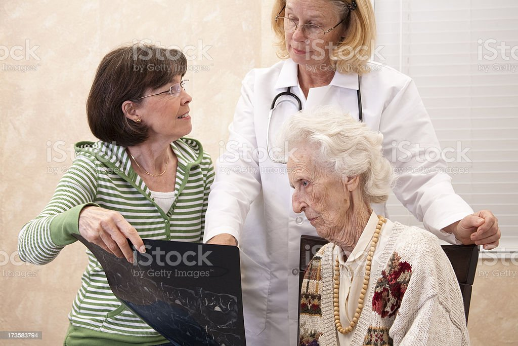 Senior woman with family and doctor. royalty-free stock photo