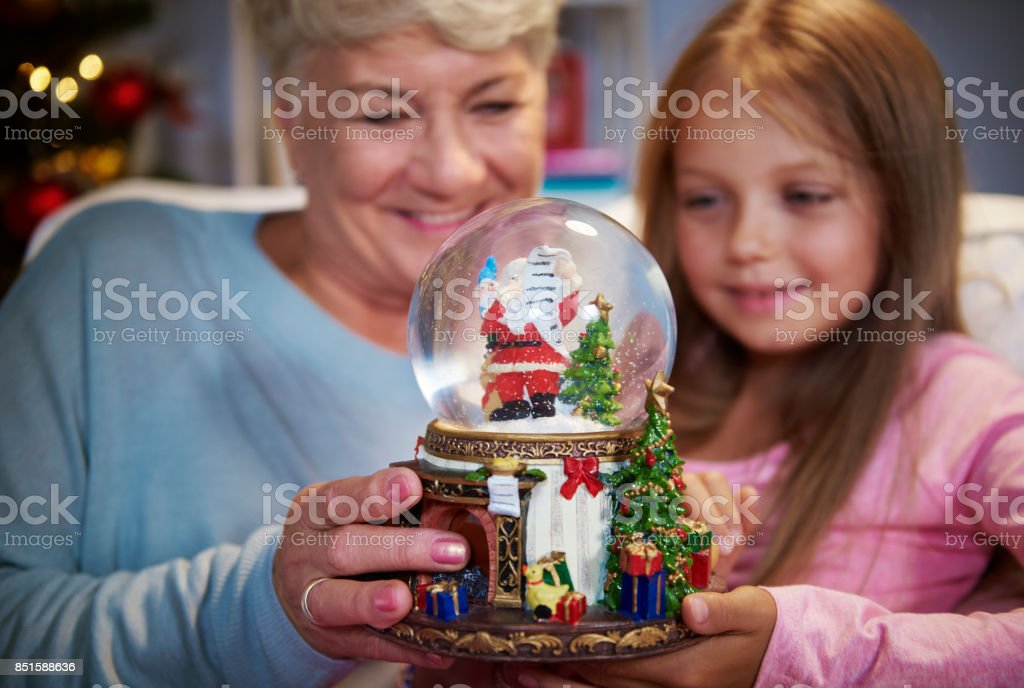 Senior woman with girl playing a glass ball stock photo