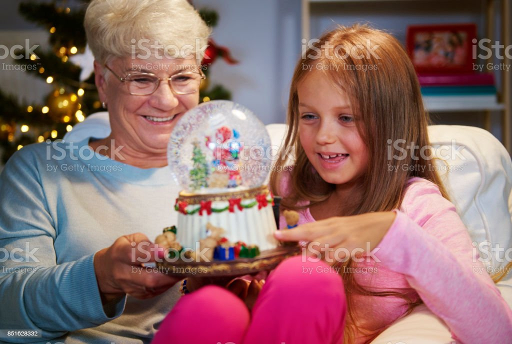 Senior woman with granddaughter holding a christmas decoration stock photo