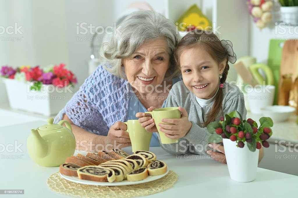 Senior woman with granddaughter with tea stock photo