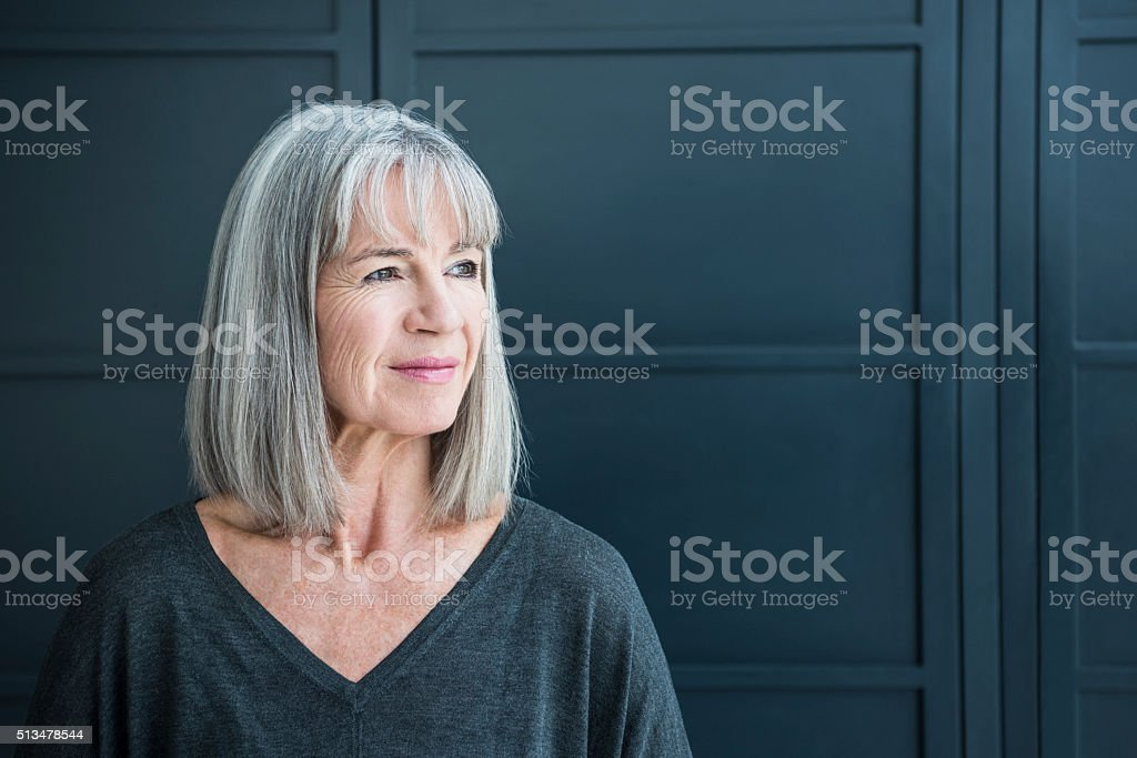 Senior woman with gray hair looking away stock photo