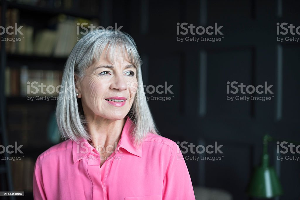 Senior woman with grey bob looking away smiling stock photo