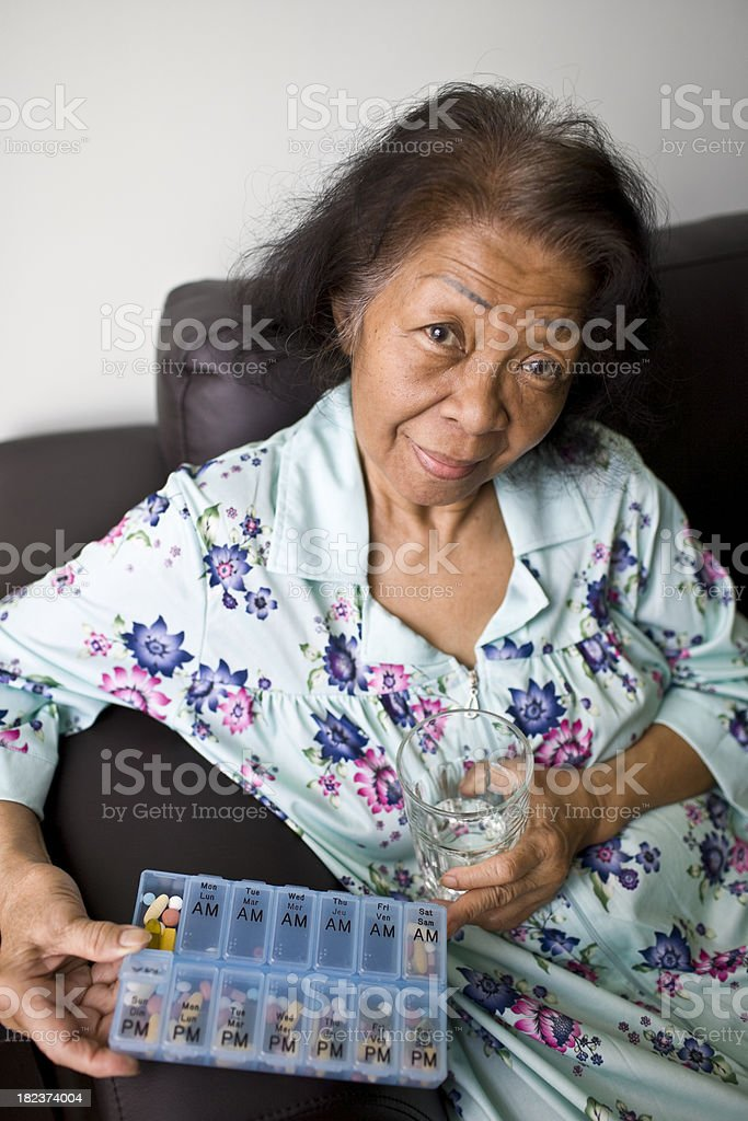 Senior Woman with her Medicine royalty-free stock photo