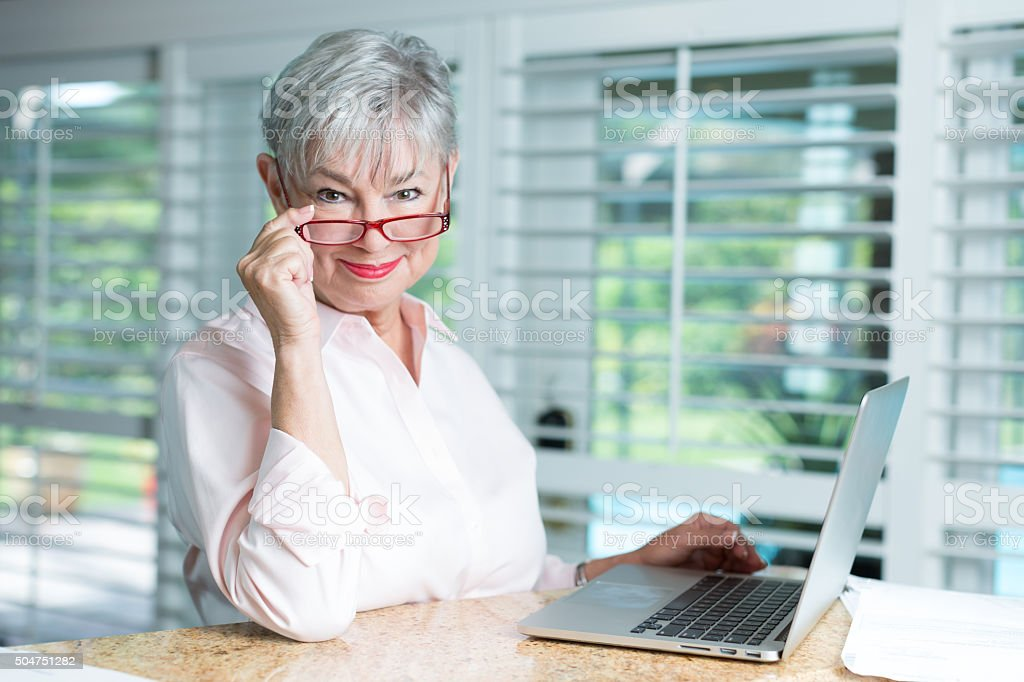 Senior woman with laptop stock photo