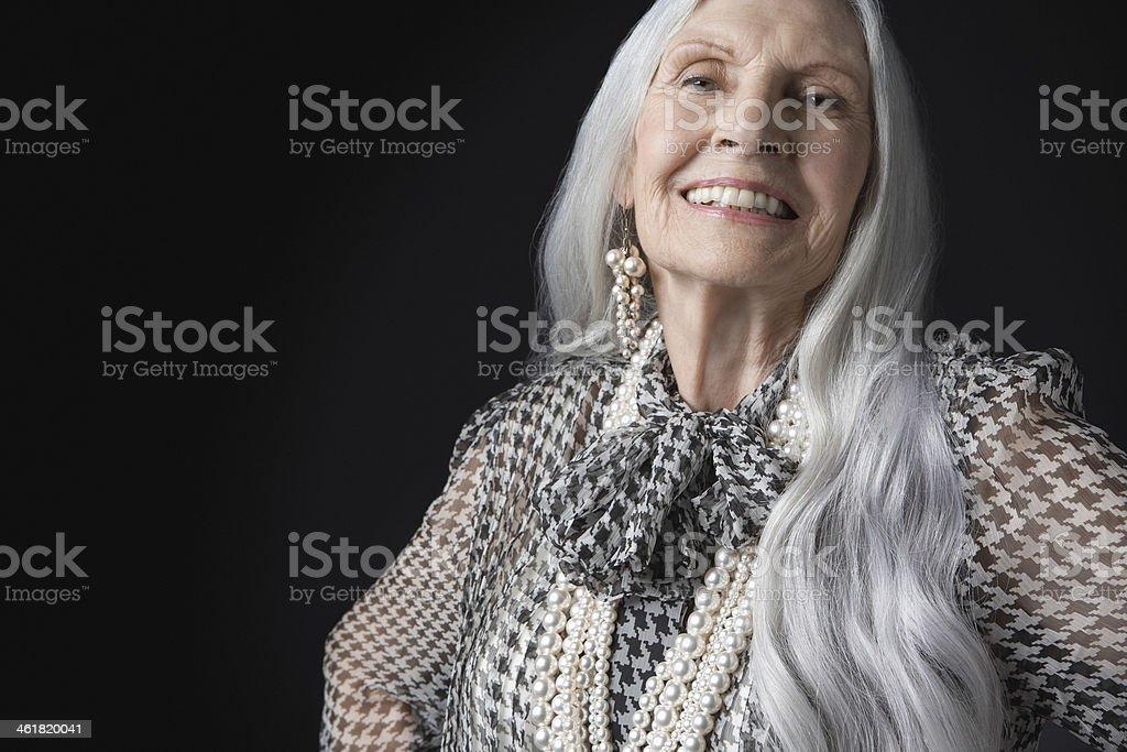 Senior Woman With Long Gray Hair Smiling stock photo