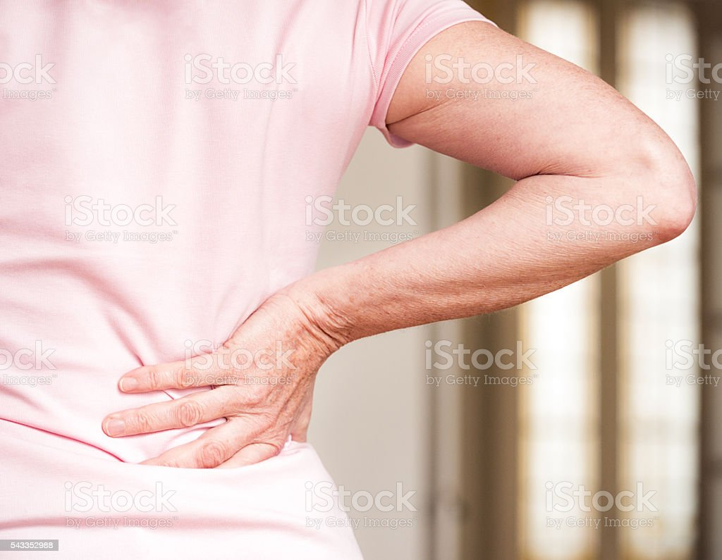 Senior woman with lower back pain stock photo