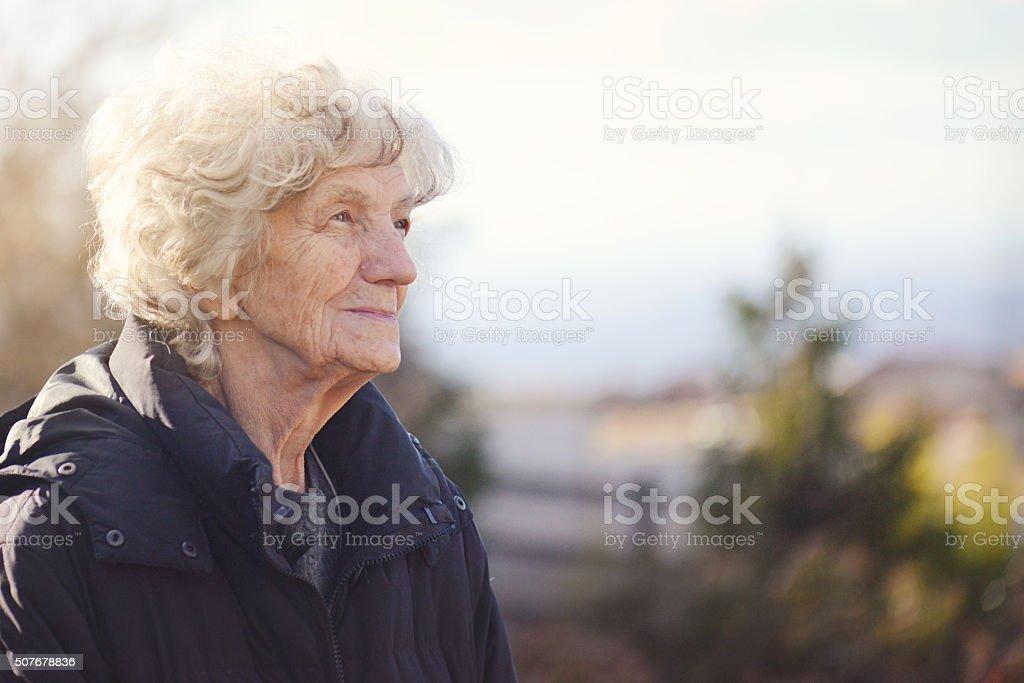 Senior Woman with Nostalgic look stock photo