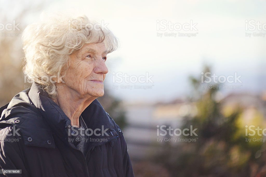 Senior Woman with Nostalgic look stock photo