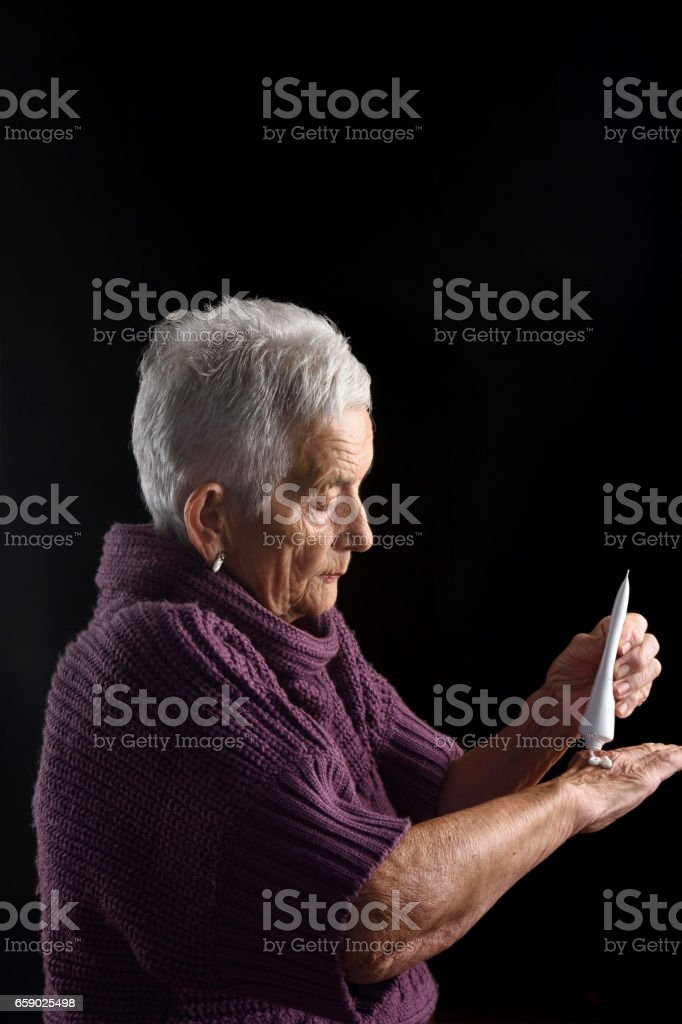 Senior woman with ointment stock photo