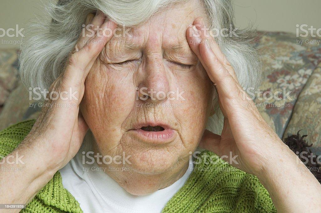 Senior woman with painful headache stock photo