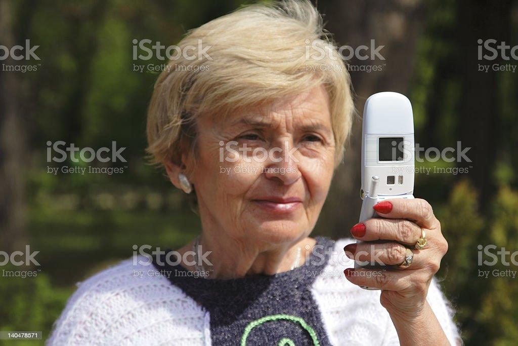 Senior woman with phone royalty-free stock photo