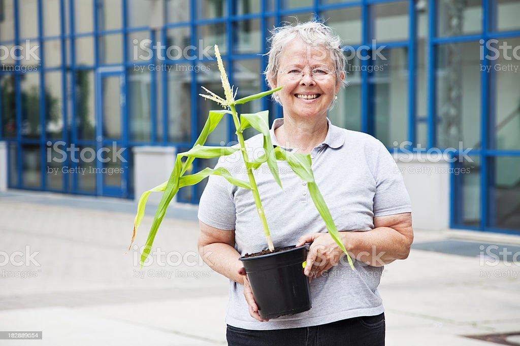 senior woman with plant stock photo