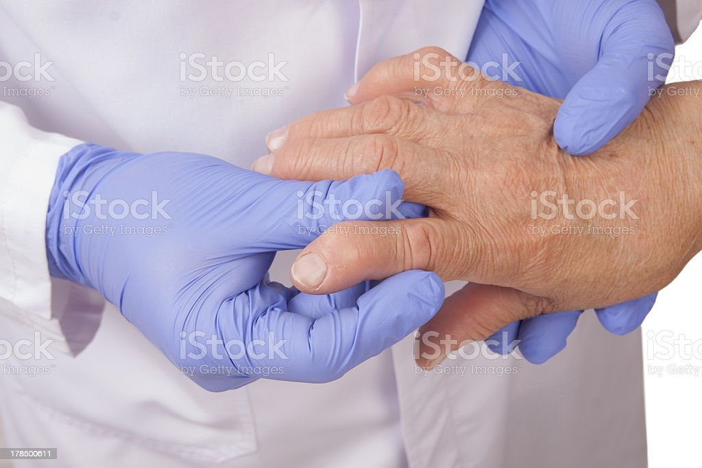Senior woman with Rheumatoid arthritis visit a doctor stock photo