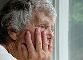 senior woman with sad expression