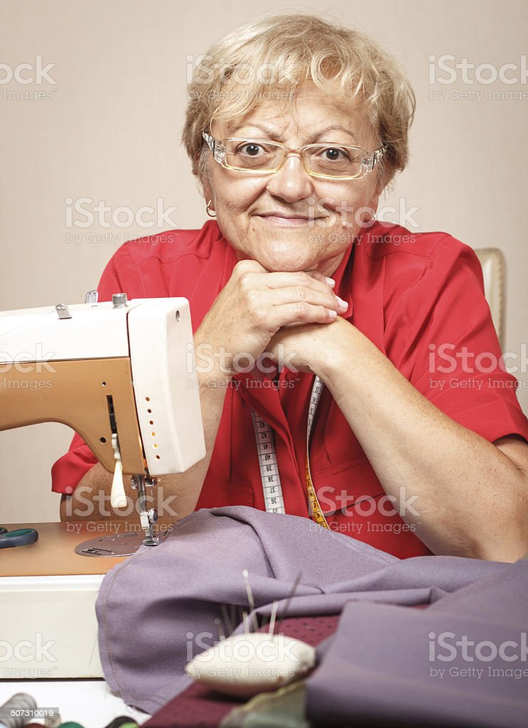Senior woman with sewing machine royalty-free stock photo