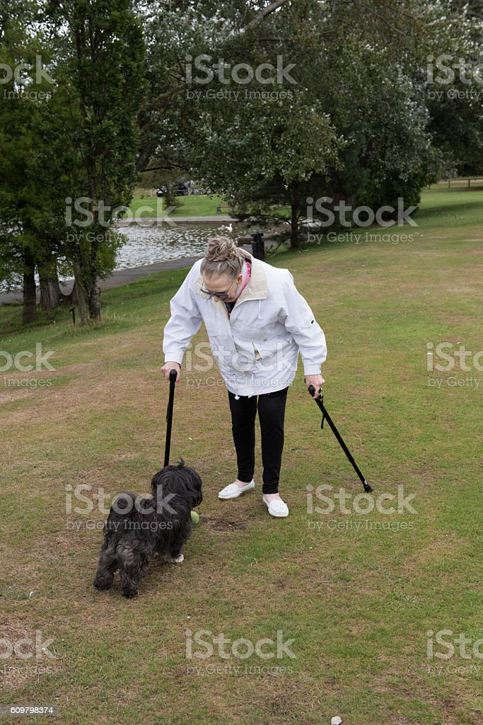 Senior woman with sticks stock photo