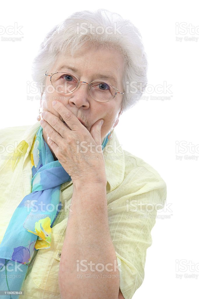 Senior woman with surprised expression and hand over mouth royalty-free stock photo