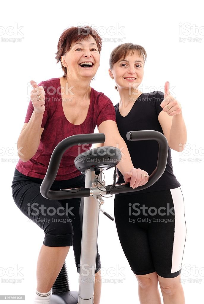 Senior woman with trainer royalty-free stock photo