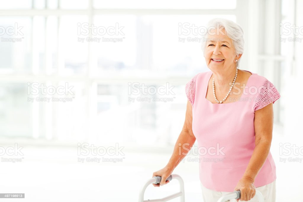 Senior Woman With Walker In Nursing Home stock photo