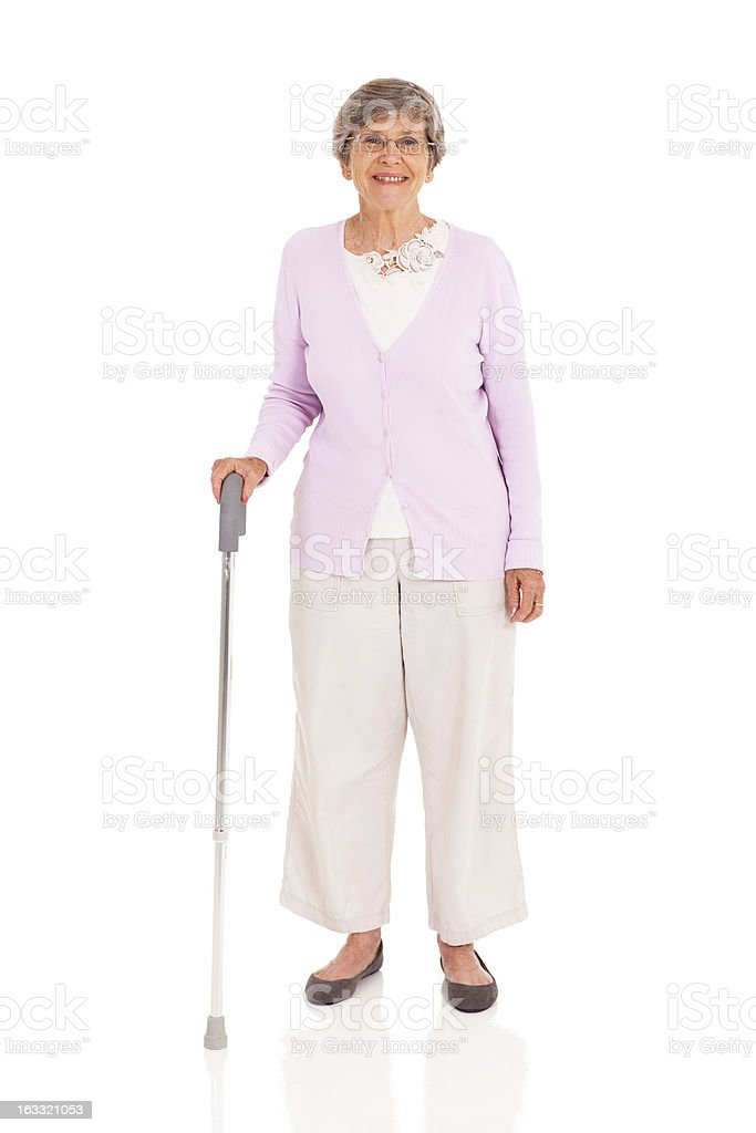 senior woman with walking cane stock photo