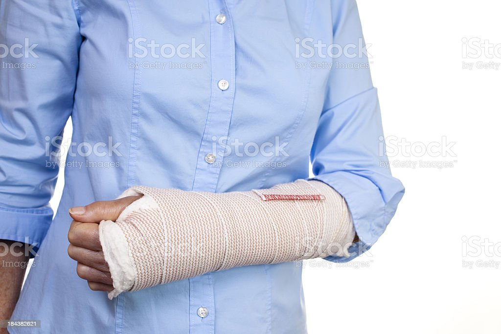 Senior woman with wrapped wrist and arm after surgery. royalty-free stock photo