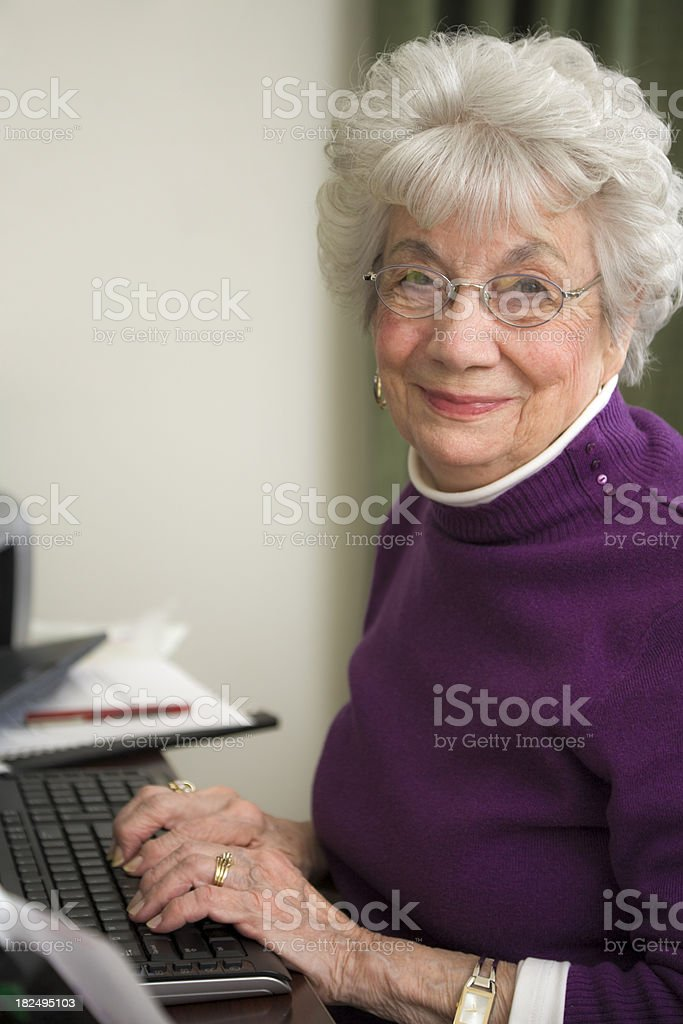 senior woman working at computer stock photo