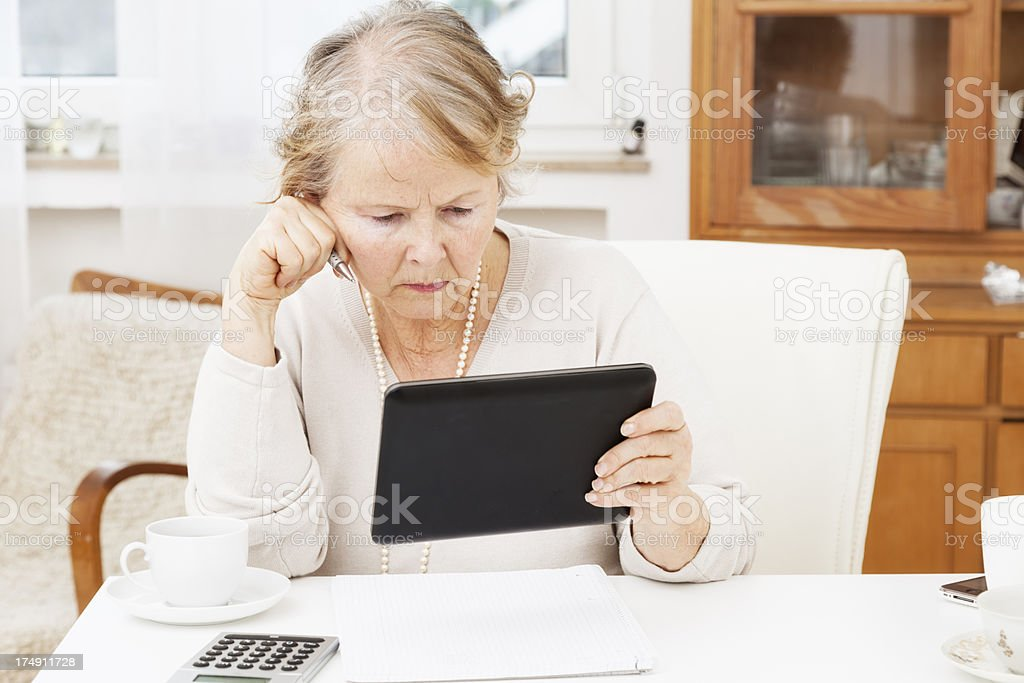 senior woman worried about finance royalty-free stock photo