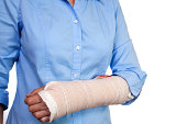 Senior woman, wrapped wrist and arm after surgery. Cast. Broken.