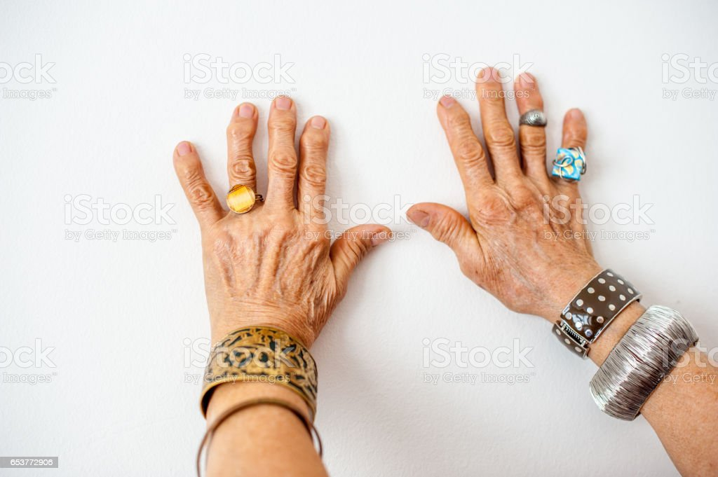 Senior Woman Wrinkled Hands Wearing  Jewerly stock photo