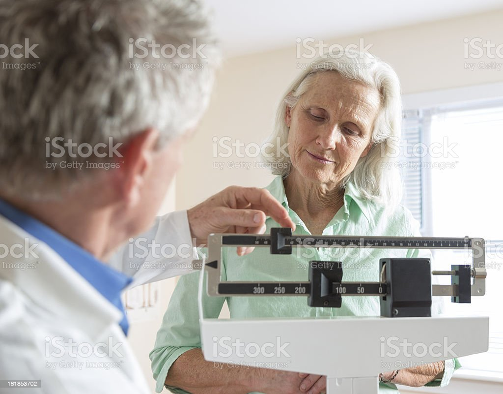 Senior Woman's Doctor Visit stock photo