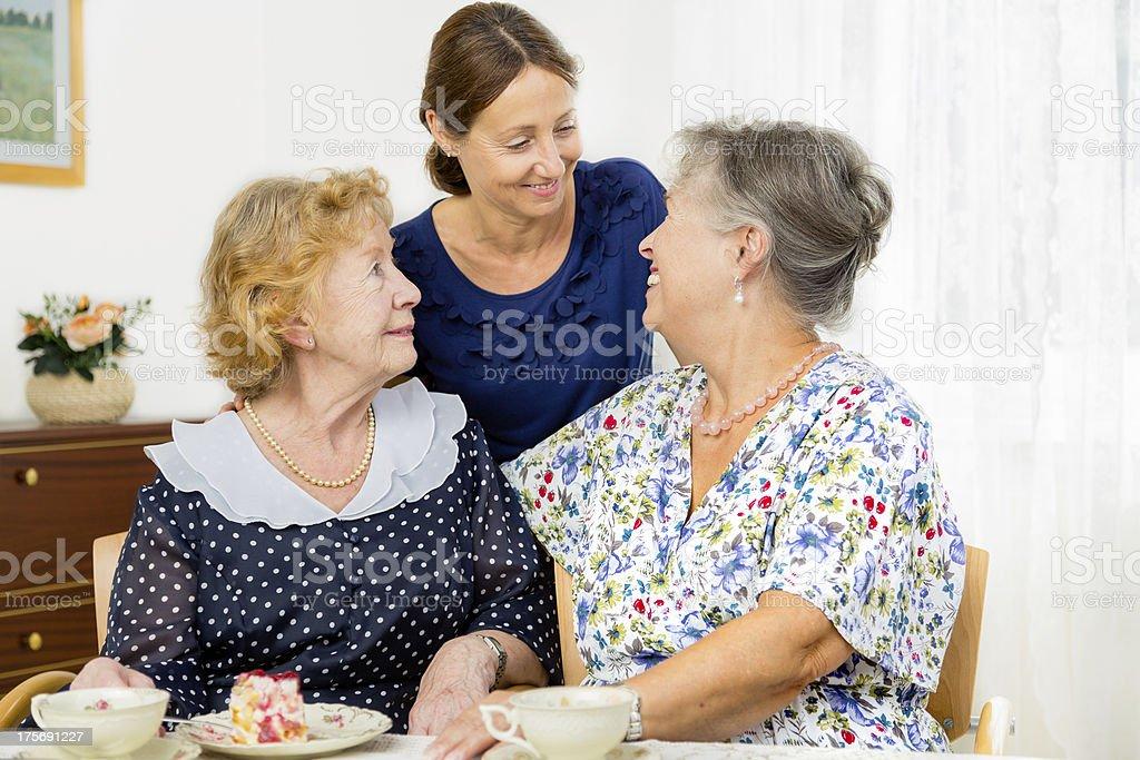 Senior women - cake coffee caregiver royalty-free stock photo