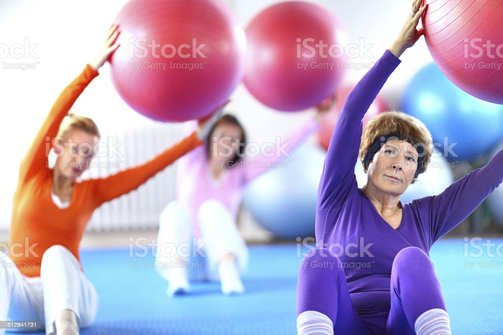 Senior women doing Pilates. stock photo