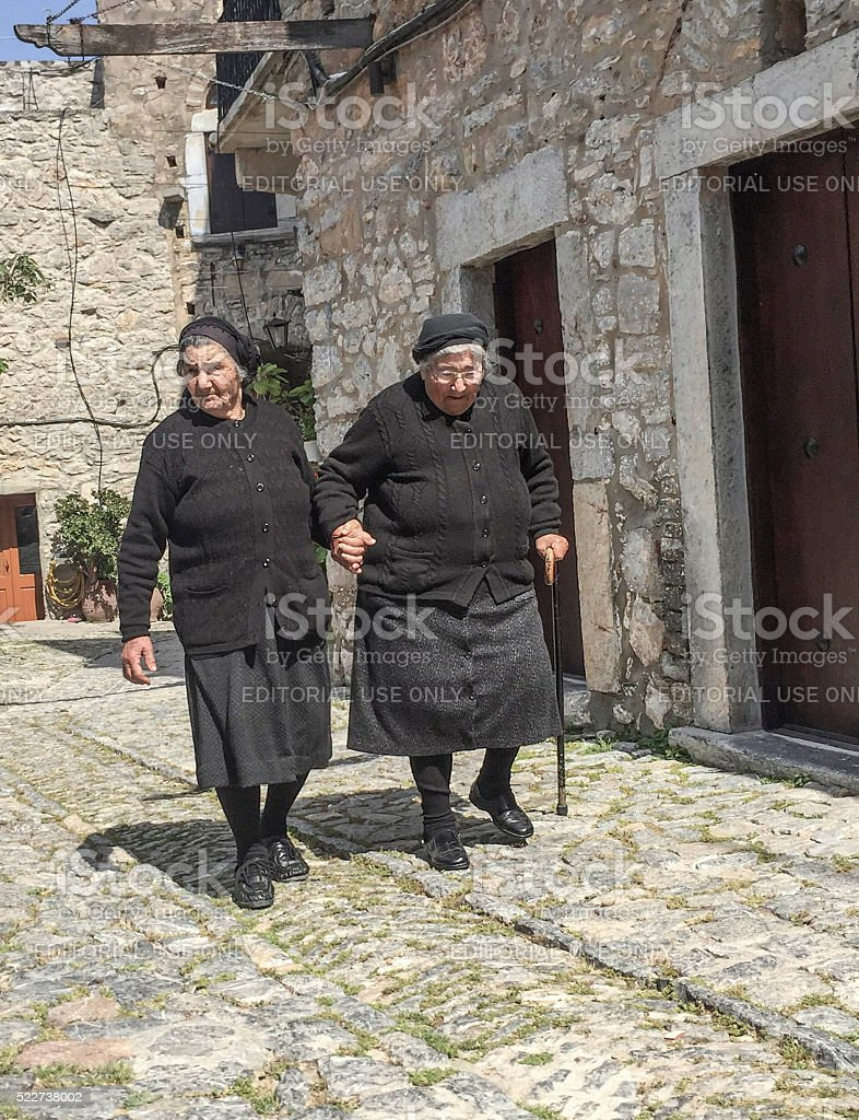 Senior women (widow) dressed in black stock photo