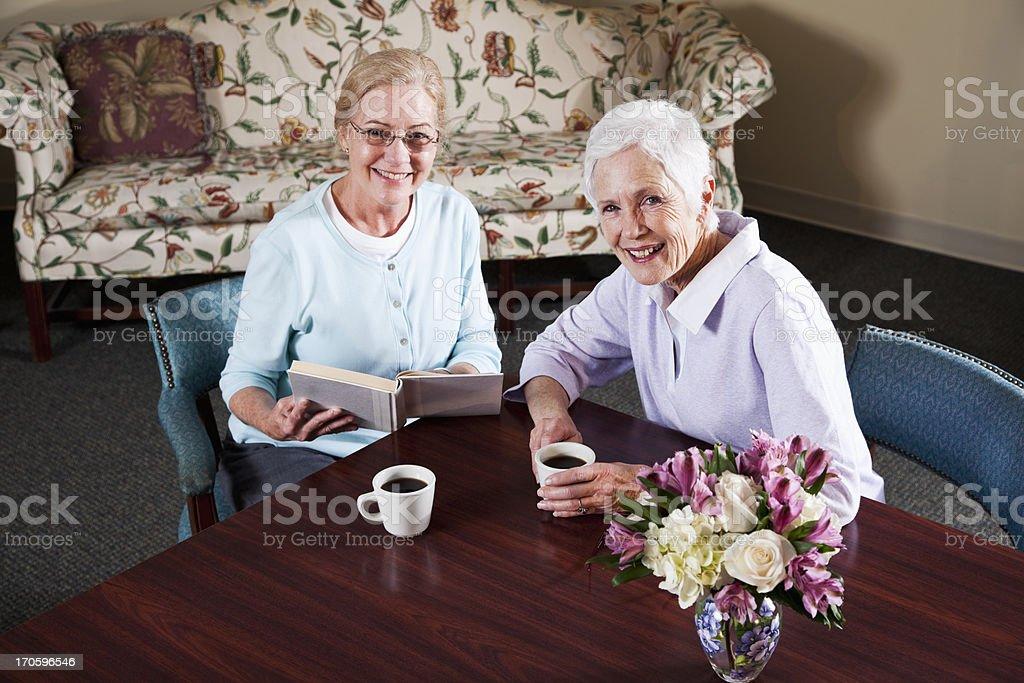 Senior women drinking coffee stock photo