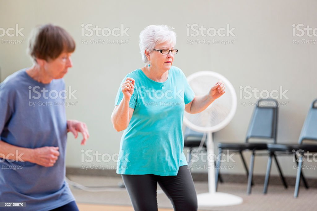 Senior women enjoying line dancing stock photo