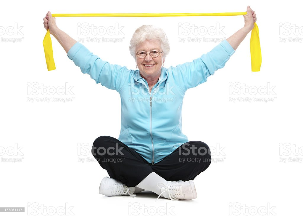 Senior women exercising at the gym stock photo