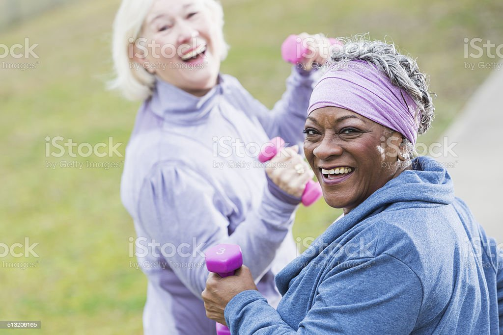 Senior women exercising stock photo