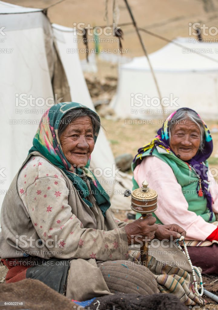 Senior women from Ladakh sitting in front of their tenthomes stock photo