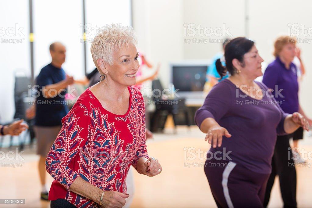 Senior women have fun line dancing stock photo
