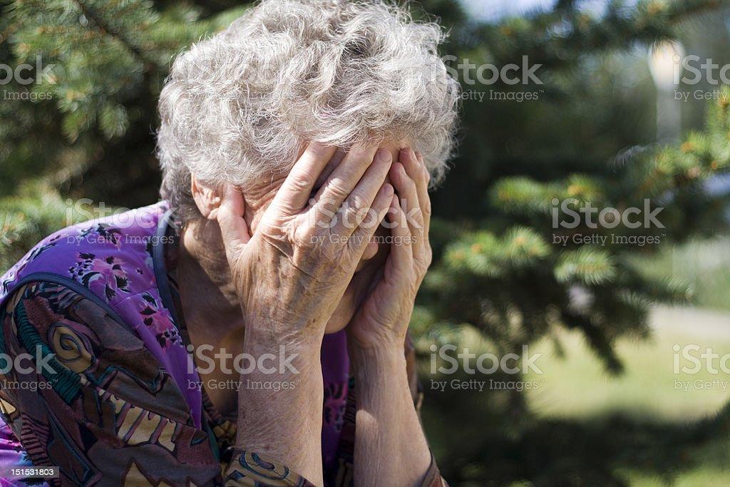Senior Women Hiding Face stock photo