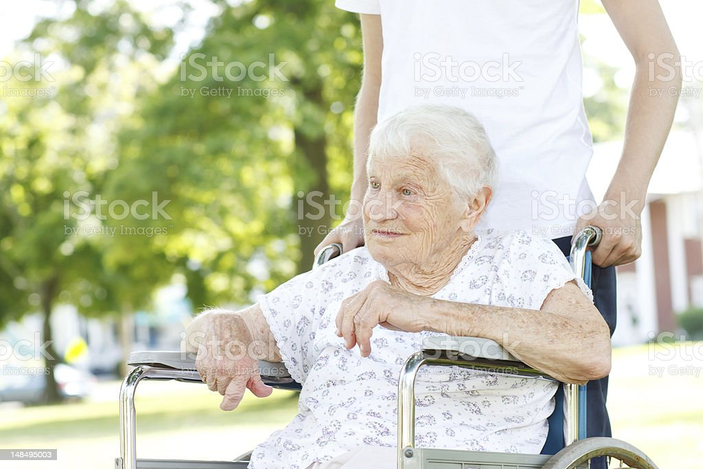 Senior Women in Wheelchair with Caretaker royalty-free stock photo