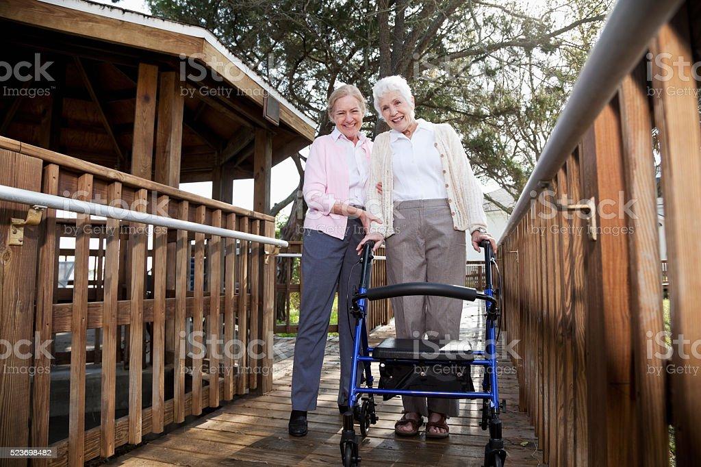Senior women on wooden walkway stock photo
